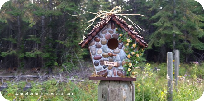 birdhouse with stone work